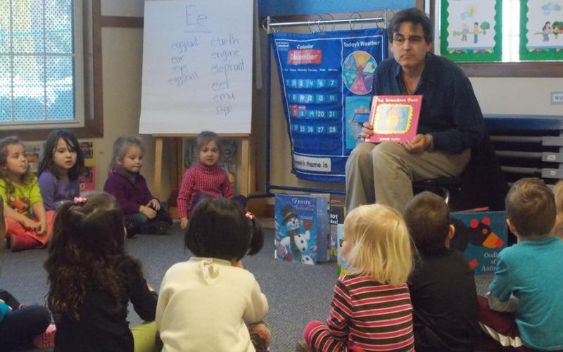 Mr. Wilson, the children's librarian from Mahwah Library, comes to read to the children every month. They love it!