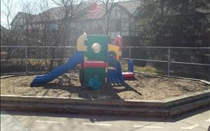 The Toddler/Discovery Preschool playground has push toys, cars and other mobile equipment to help the children develop their gross motor skills. There is also an area for group games and sensory exploration.