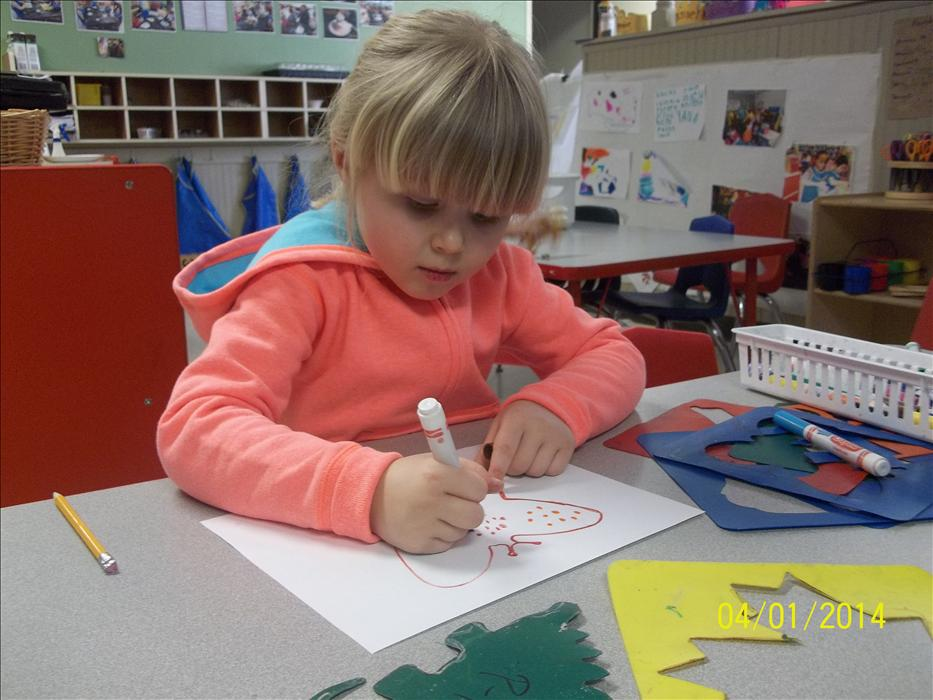 Teachers encourage children to express themselves creatively through art.