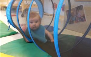 The babies love to crawl through the tunnel as they work on their large-motor skills and coordination.