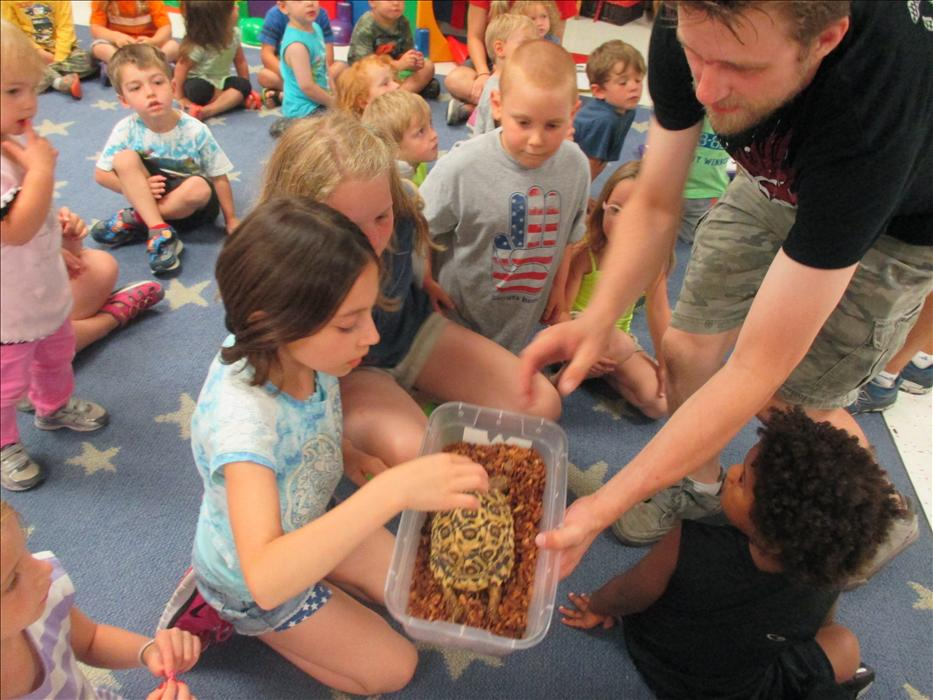 The Pine St KinderCare students loved learning all about reptiles!