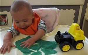 We encourage infants to explore through art, music and movement.