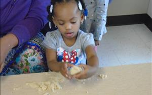 Play dough fun in the Toddler Room is a fun sensory and fine motor activity.
