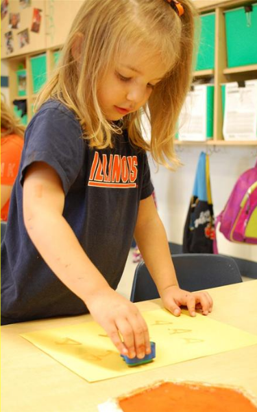 Preschool is using letters to stamp with, one of the many ways we teacher letter recognition.