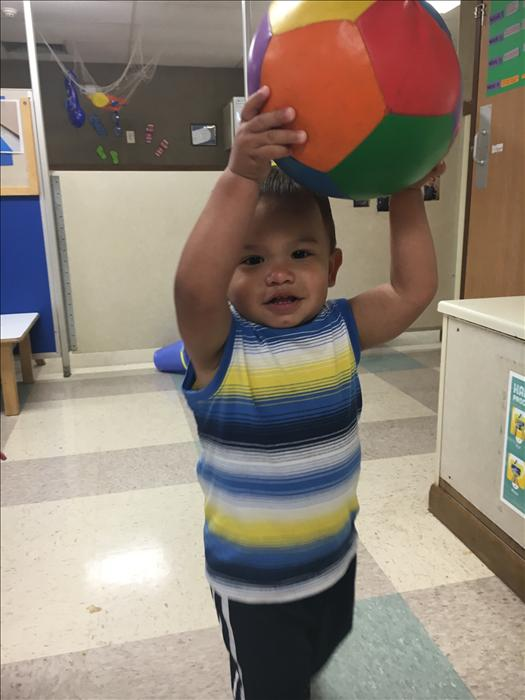 Toddlers can play games that develop their throwing skills and show an increase in their ability to control hand movements.