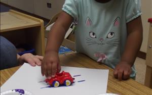 "Learning about ""Things That Go"" by creating car tire tracks with paint!"