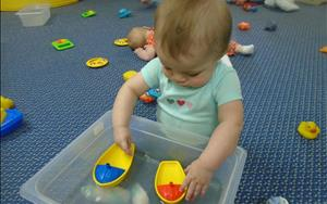 Infants Exploring Water and Boats