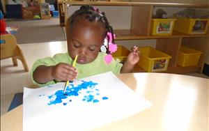 Our Toddler children develop fine motor skills while painting the weather