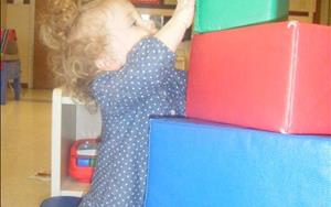 Children under 2 years of age learn through exploration.  Look at how high this toddler can build!