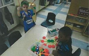 These children in our Pre-K program are engaging in small-group activities with friends.
