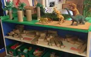 Our block area in Preschool was transformed for them to build Dinosaur habitats