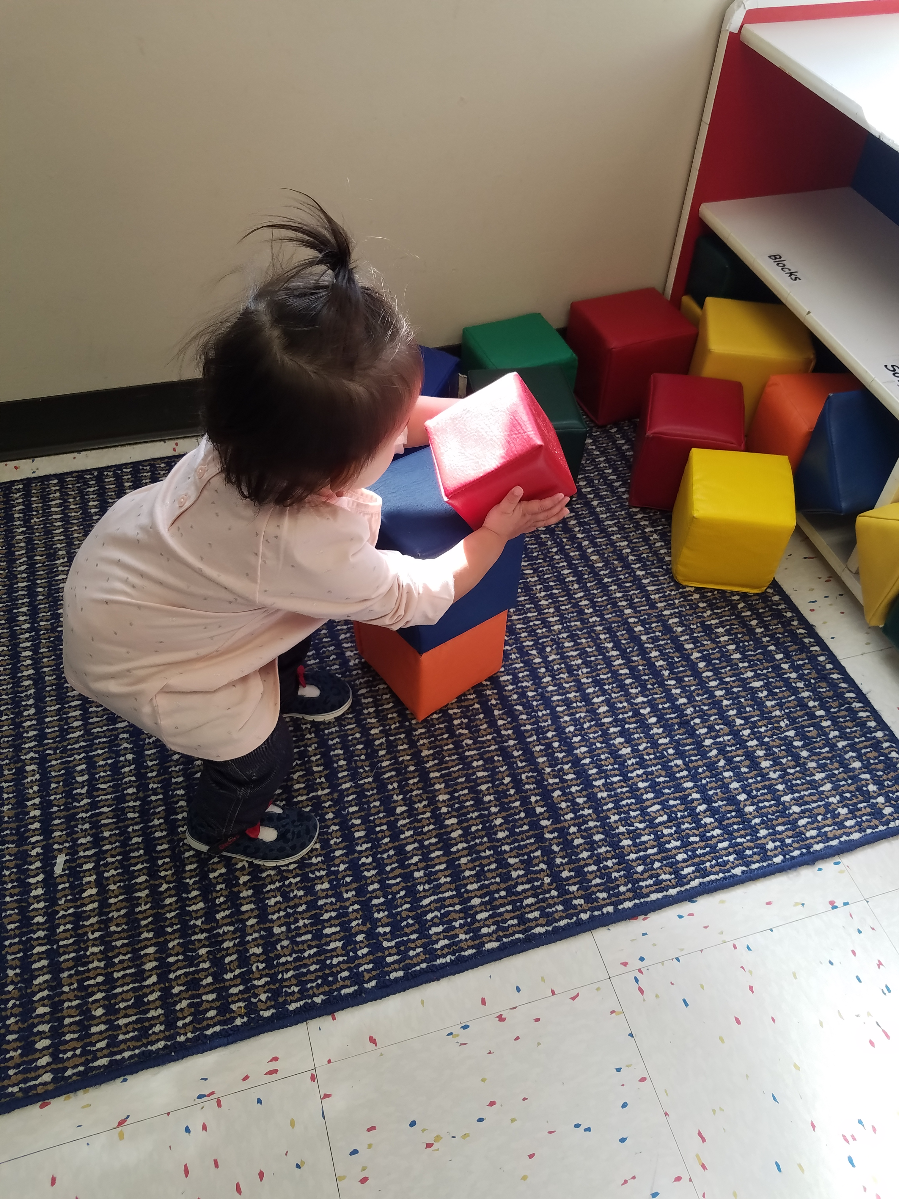 Our Toddler room teaches children ages 15 months to 2 years. Learning centers focus on different skills daily.