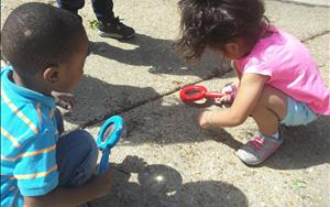 We take the Preschool curriculum outdoors...we had fun looking for bugs using magnifying glasses!