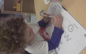 Our preschoolers practice their emerging writing skills by writing in their journals daily.