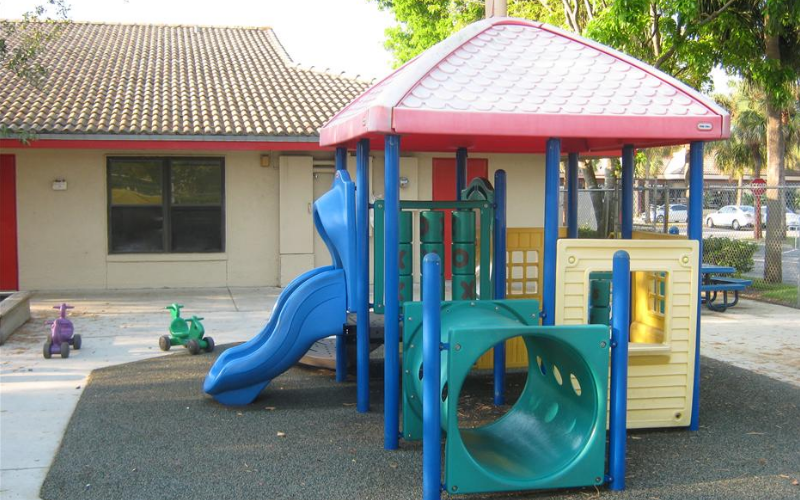 Our toddler playground has age appropriate equipment, rubberized matting around it, push/riding toys that encourage our smaller students to develop their large motor skills while having fun.