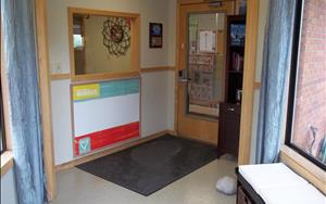 This is the first area that you will encounter when you visit our center.  There is an area for families to sit as well as informational books.  There is a window that allows the Center Director and Assistant Director the chance to see who is entering the building.  The door also has a code that only current families know.