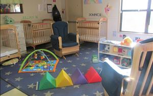 We work with infants in a least restrictive environment, spending most of the time on the floor helping them learn and grow at their own pace.