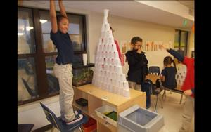 Building cup towers is just one of the fun activities that our school-age children do together after school.