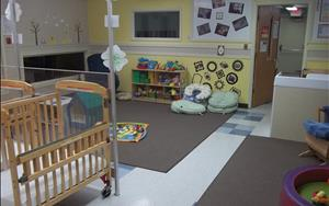 The infant classroom has a great large space for exploring and low windows that the children can look out of.