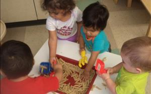 Our infants exploring during wet and messy play!