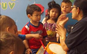 Our Toddler Teacher Ms. Shashi leading the Toddler and Discovery Preschool classes in Music Adventures.