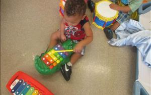 Our toddlers love to play music!