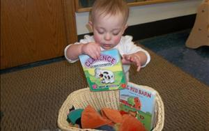 Having fun exploring our Infant discovery basket; learning all about the farm and it's animals!
