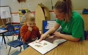 In our Preschool classroom our teachers model reading and writing daily in a variety of activities including read-alouds and charting.