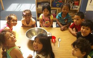 Preschool students are getting ready to participate in their cooking activity!