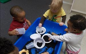 Toddler Science - having fun exploring dirt at the sensory table.