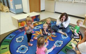 Toddler Classroom calling out their own names at group time.