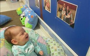 Happy to see her family picture up on the wall on her third day at KinderCare!