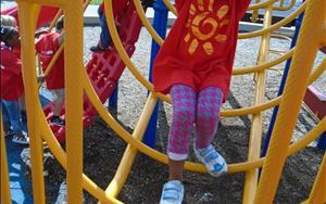 The Prekindergarten children enjoy daily large motor activites on the playground.