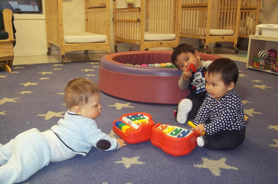 Our Infant class experimenting with musical instruments.