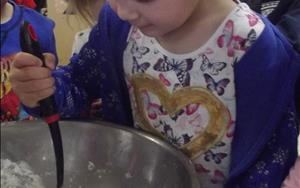 This child loves to cook, even at school! Our children have the opportunity to make their own bread bones during Healthy Bodies week!