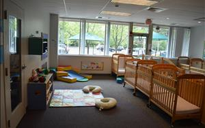 Infant classrooms include toys and materials for babies of all developmental stages to explore.