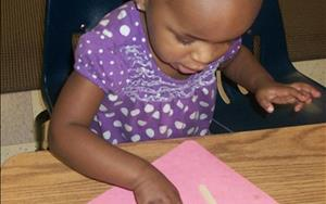 Our Discovery Preschool classroom helps children develop their fine motorskills.