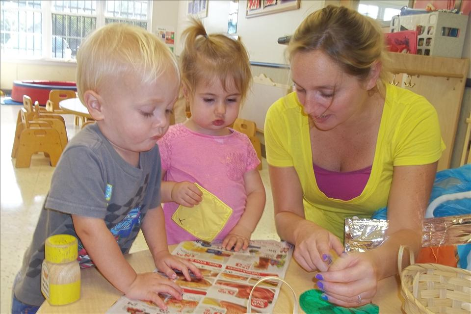 Ms. Laura and her two year olds are learning about the different foods they could find at the community grocery store.