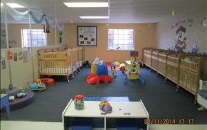 Our infants enjoy a clean open space where they can move freely and develop their whole body.