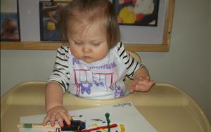 One of our infants painting.