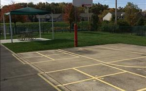 "Our ""back yard"" playground space includes a basketball court for School Age children to enjoy"