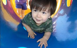 The children in our Toddler Program have fun crawling through the tunnels on the playground outside! This activity encourages them to develop controlled movements through play.