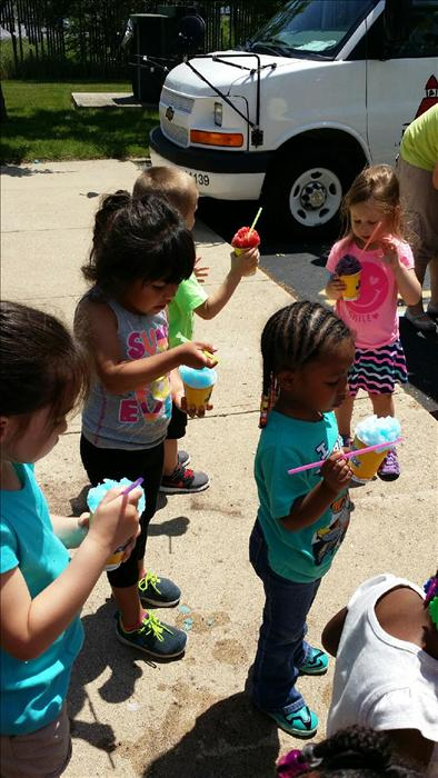 Preschool students are enjoying snowcones from Kona Ice during our Summer Camp.
