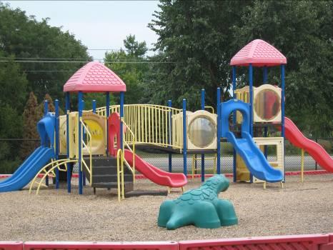 The larger playground is for Preschool through School-age children.  There is also a large open grassy area for a great game of kickball and picnic tables for enjoying the weather for special meals or snacks.
