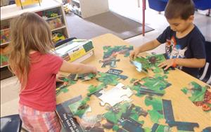 Working together putting together a puzzle.