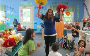 Ms. Lupita showing our school age children how to Hula.