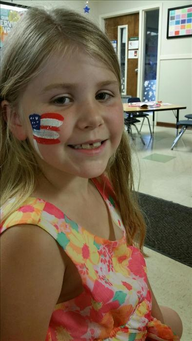 A student in our School Age classroom is celebrating our Fourth of July Cookout Celebration.
