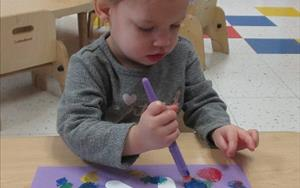 We provide a variety of age-appropriate materials so toddlers can express themselves through artwork, songs, and movement.