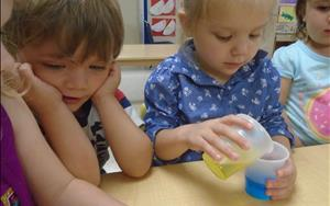 Twos learning about science by mixing colors