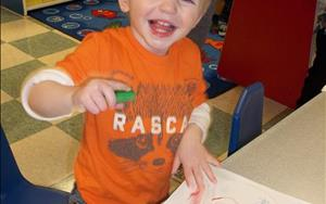 Practicing fine motor skills in the toddler room